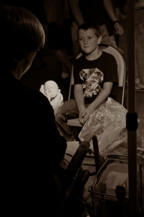 this little boy was so precious sitting for the artist