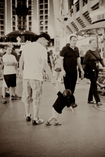 little one learning to walk... with daddy there to keep him from falling.
