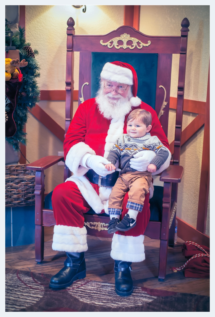 Luke and Santa posing for the camera.
